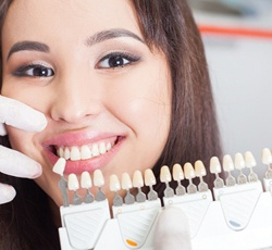 attractive woman posing with porcelain veneers