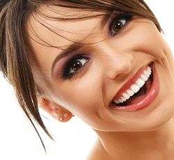 woman brunette hair smiling perfect teeth